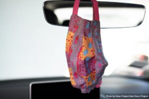 Brightly colored cotton mask hanging car mirror by Noun Project from Noun Project