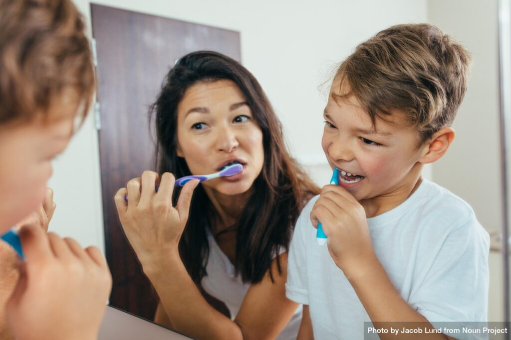 Mother and son brushing teeth in bathroom by Jacob Lund from Noun Project https://thenounproject.com